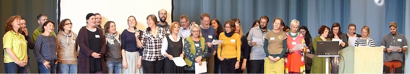 """More than 30 participants on stage in Berlin say the song """"I am a woodkid"""" written for the International Day of the Waldkindergarten by the musician and nature pedagogue Marius Tschirky from Switzerland"""